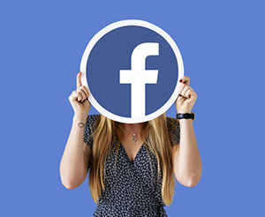 woman holding facebook logo