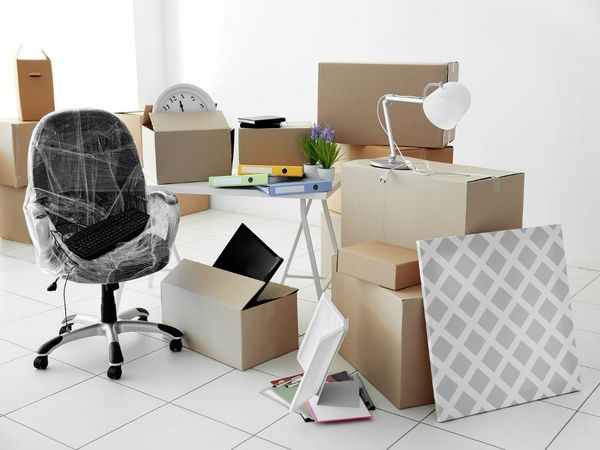 packed office chair and boxes